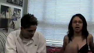 Black haired cutie in glasses and stockings gives blowjob