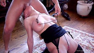 tugging on her nipple clamps