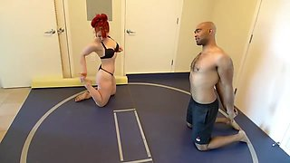 Red headed girl vs black guy wrestling