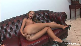 All alone well-shaped nympho slowly undresses and rubs her own clit