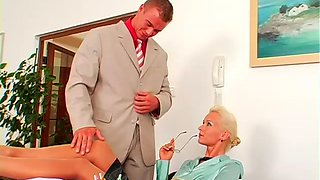 Sexy blonde secretary allows her boss to suck nipples