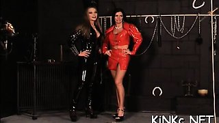 2 submissive slaves of nasty mistress in latex