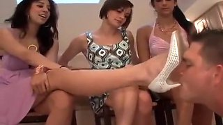 Three mistresses abuse a slave with their feet