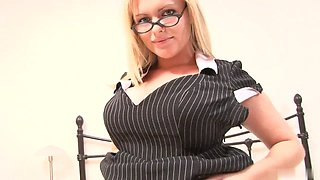 Geeky secretary with glasses strips after a hard day at work