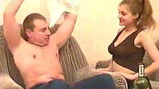 Redhead skank strips and gives a blowjob to a kinky dude