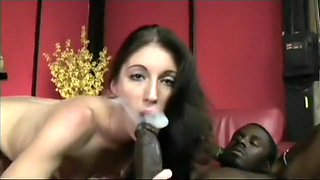 A cigar smoking beauty takes some big black meat between her lips