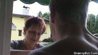 Granny rides her neighbour\'s cock