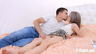 Modern young couple have some afternoon fun in bed
