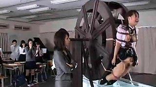 Kinky Asian schoolgirls getting trained on the water wheel