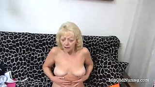 granny rubs her clit with a sex toy